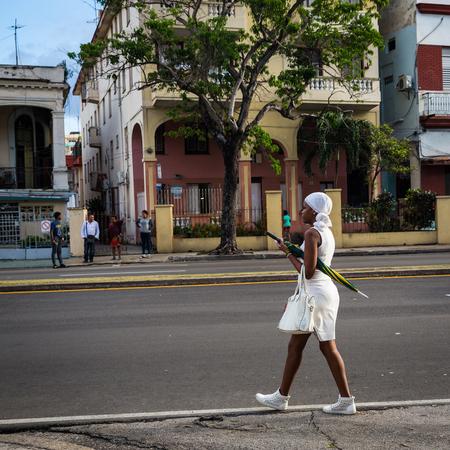 HABANA, CUBA-JANUARY 13: People in the city street on January 13, 2018 in Habana, Cuba. People in the city street
