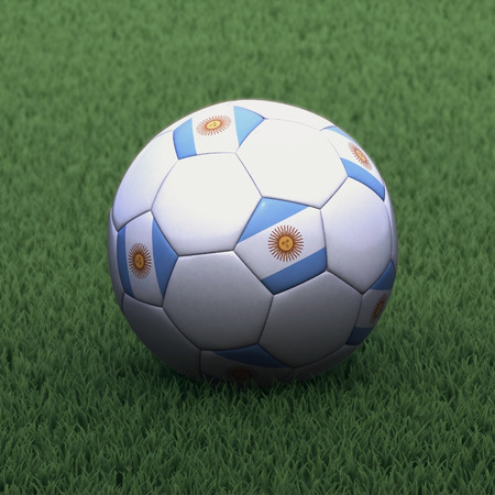 argentinian flag: football branded with the Argentinian flag on green grass