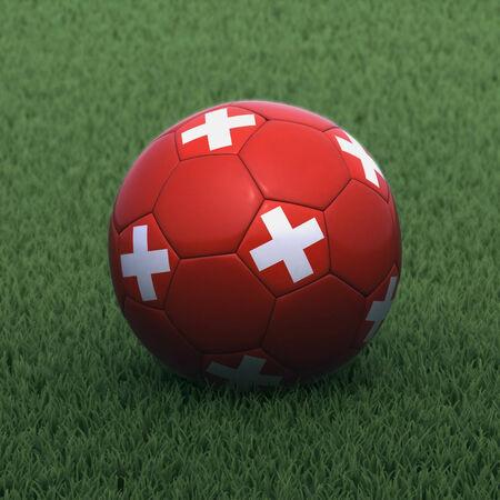 zwitserland vlag: voetbal gebrandmerkt met de vlag van Zwitserland op groen gras