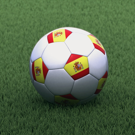 branded: football branded with the Spain flag on green grass