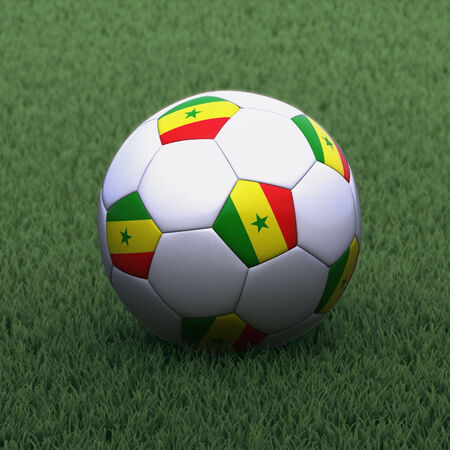 branded: football branded with the Senegal flag on green grass Stock Photo