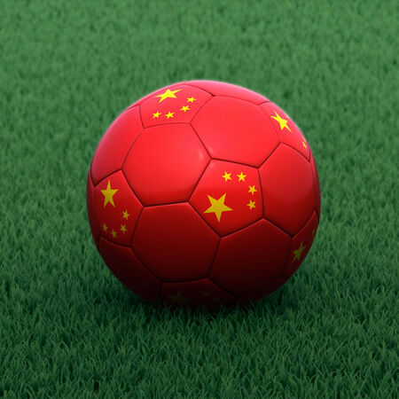 branded: football branded with the Chinese flag on green grass Stock Photo