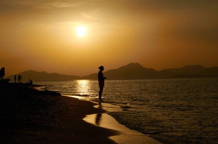 Trópusi naplemente és a lövés a parton Stock fotó