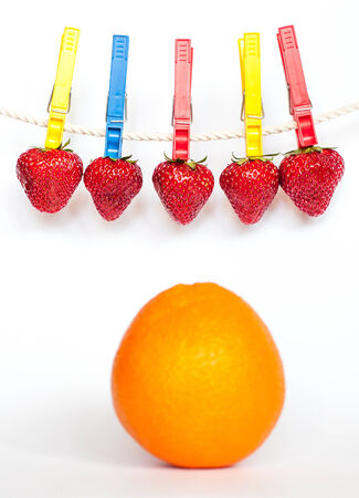 strawberies: Strawberries on the rope and an orange