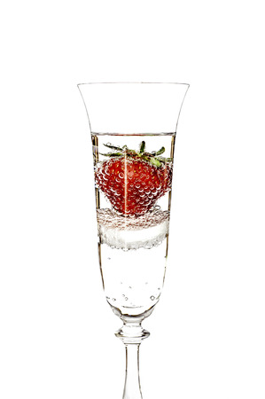 Bright erd berry in the glass with fizzy water