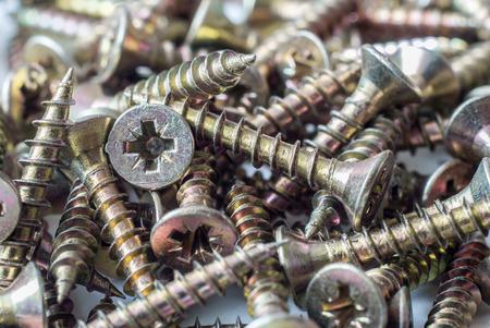 tornillos: Screws closeup. Construction. Hardware. Carving on metal self-drilling screws.