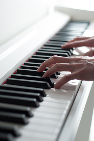 ivories: Man playing the piano. Piano keys. Piano playing. Black and white keys. Electronic piano. Musical instrument.