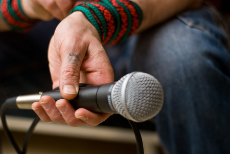 soloist: The singer is holding a microphone. Microphone in hand. Stock Photo