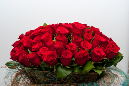 Bouquet of red roses on a wall background