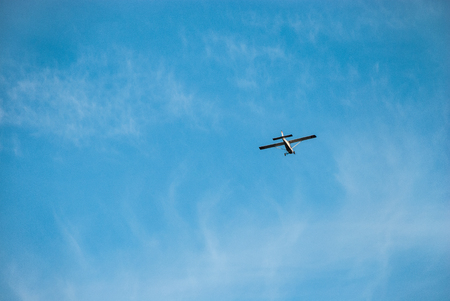 Flying aircraft against the blue sky Stock Photo