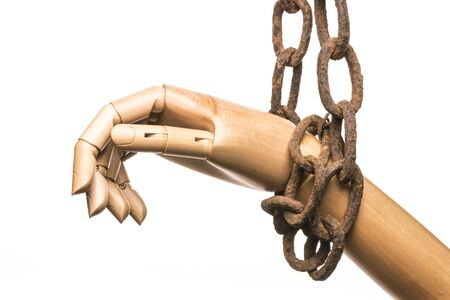 Hand attached to an old rusty chain on white background