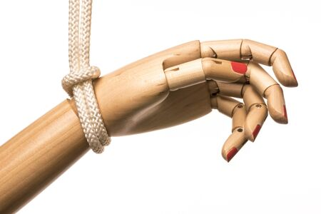 White woman hand attached on white rope in black background Stock Photo