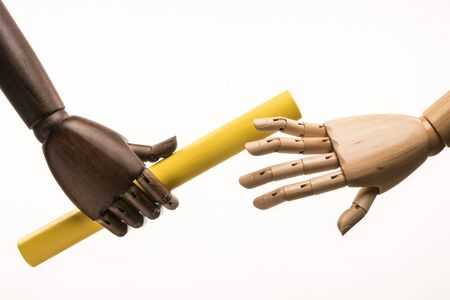 Handover between a black hand and a white hand. Isolated on white background.