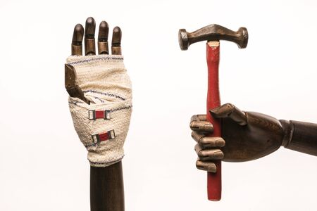 mockery: Rugged hand, with hammer wound, bandage and care. On white background.