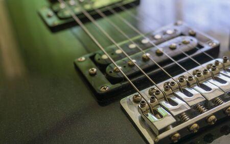 Electric guitar part close-up. Neck and humbucker pickup. Horizontal composition. Studio shot. Stock Photo