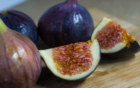 Fresh fig fruits arranged on wooden table