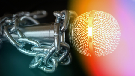 Microphone and chain. Freedom of the press is at risk concept - World press freedom day concept