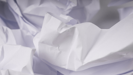 crumpled paper on white table brainstorming in the office concept