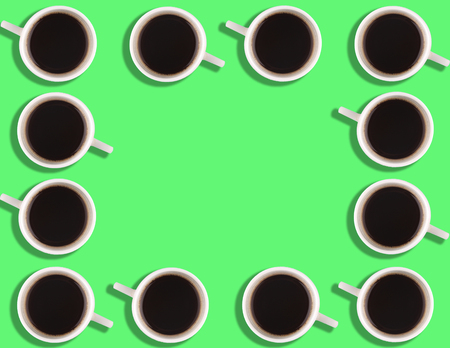 A pattern of small coffee cups on a bright colored background with copyspace. Stock Photo