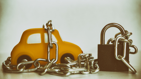 Vehicle security with padlock and chain on white background. Close up.