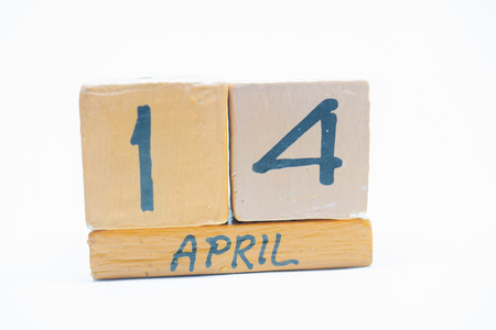 april 14th. Day 14 of month, handmade wood cube calendar isolated on white background. spring month, day of the year concept Imagens