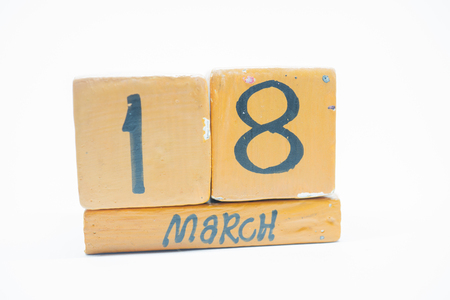 march 18th. Day 18 of month, handmade wood cube calendar isolated on white background. Spring month, day of the year concept. Banco de Imagens