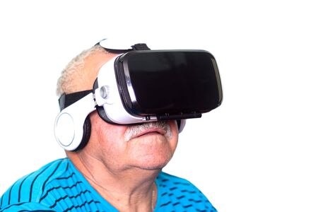 technology, augmented reality, gaming, entertainment and people concept - senior man in virtual headset or 3d glasses opens new reality for himself. isolated on white Stock Photo