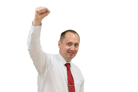 Portrait of happy young man in shirt and red necktie celebrating, gesturing, keeping arms raised and expressing positivity. Isolated on white. young handsome excited man with hands up.