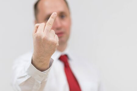 Hand of Businessman show sign isolated on white background. portrait of handsome man showing middle finger, impolite and rude off expression