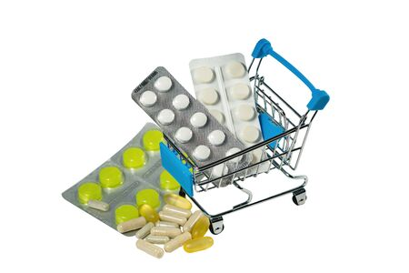 Medical pills in blister packs in a shopping cart isolated on white background Stock Photo