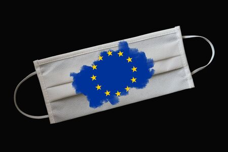 Medical mask with the image of the flag of the European Union. Concept of the Covid-19 coronavirus pandemic. Global threat to the countrys population Stock fotó