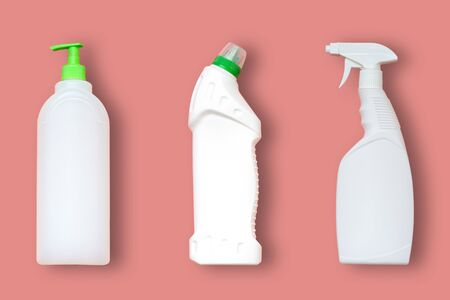 3 types of plastic bottles for household chemicals. Packaging for liquids. Empty, clean white plastic containers. Top view on a pink pastel background