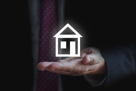 loan or real estate concept. Businessman holding home model. holding home for selling and buying strategy Stock fotó