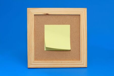 padding: Yellow note paper is pinned to the framework, bulletin board.