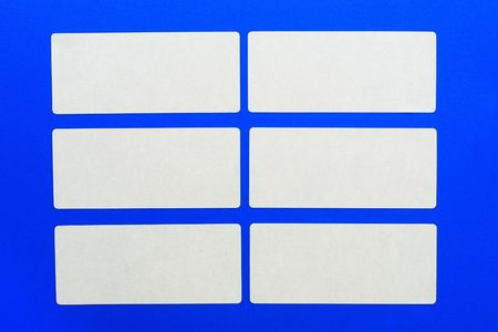 padding: White cards on a blue background.White paper. Stock Photo