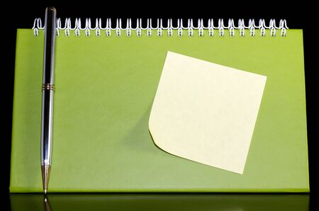 Green blank notebook organizer with pen and noteped Archivio Fotografico