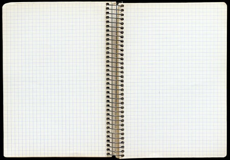 Open notebook with a spiral binding and checkered sheets.