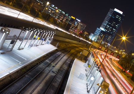 Highway and railway station with road traffic in Tel Aviv at night photo