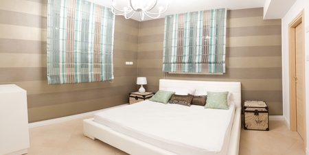 luxury hotel room: Bedroom with furnishings in a new house.