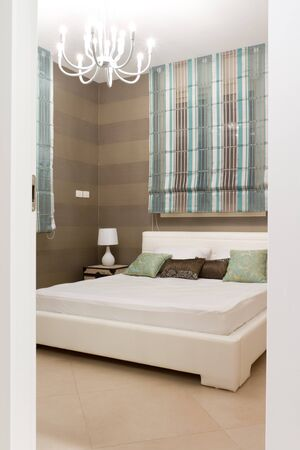 Bedroom with furnishings in a new house. Stock Photo - 11873534