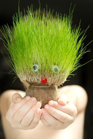 Grass head magic toy in the hands of child