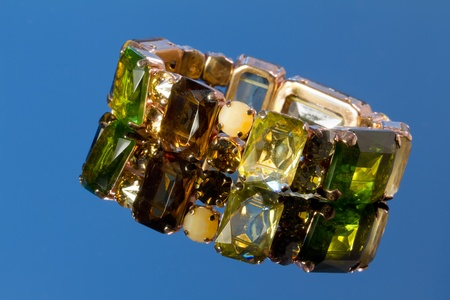 Bracelet with gemstone set on a blue background