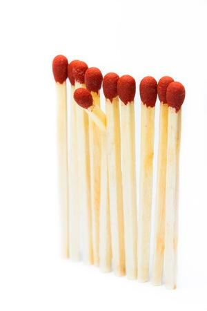 One broken matchstick stands in the matchsticks set photo