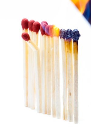 another: One broken match in a set of burning matches Stock Photo