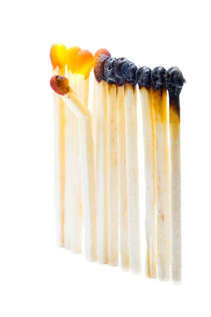 One broken match in a set of burning matches Stock Photo - 11986126