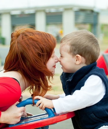 Mother and son on playground. Children send a thoughts. photo