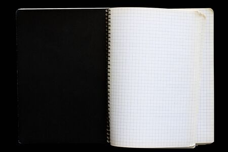 ring binder: Open notebook with checkered sheets with black one side Stock Photo