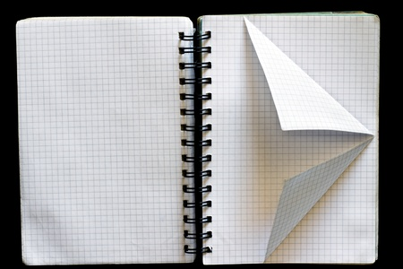 Notepad with a spiral binding and curved sheets photo