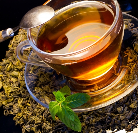 A cup of english green tea with mint Stock Photo - 12332835