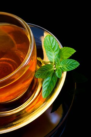 A cup of english green tea with mint Stock Photo - 12332834
